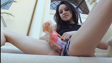 Hot teen stuffs a Barbie into her pussy