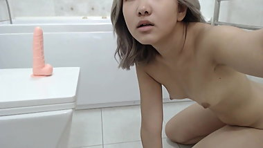 An Asian Girl Masturbates In The Shower