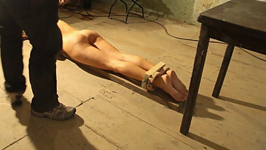 Test of torture instruments on the feet of a slave