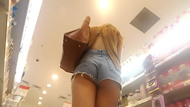perfect ass girl cheeks out shorts