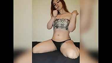 Teen redhead smoking cigarette in bikini and wet hair