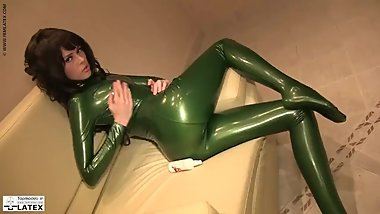 Brunette in Green Latex Catsuit