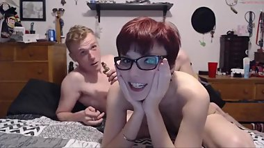 adorable chick in glasses with bf on webcam