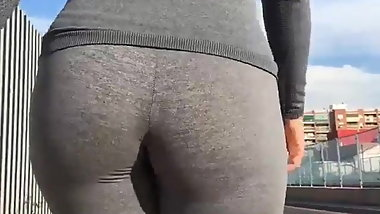 Bouncy ass in tight leggings walking