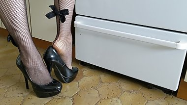 Cooking in platform stripper heels and fishnet stockings