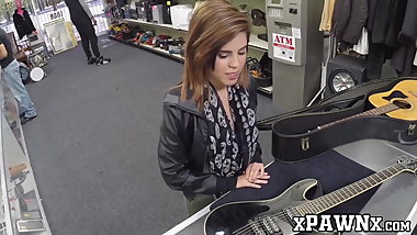 Good looking gal has steamy fuck session in the pawnshop
